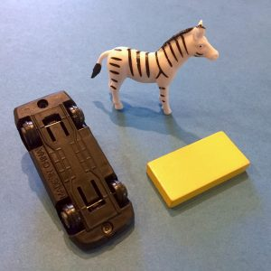 A car, zebra and block that could be used to play the teaching game PORTL